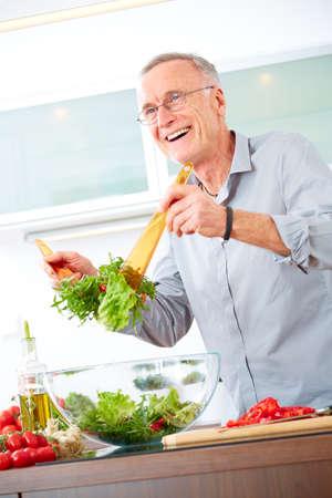 One Mature in the kitchen prepare salad