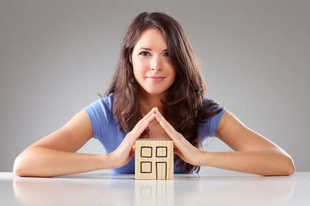 contend: Young woman make a roof with hands symbolical