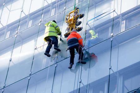 cleaning team: Repair on a glass facade