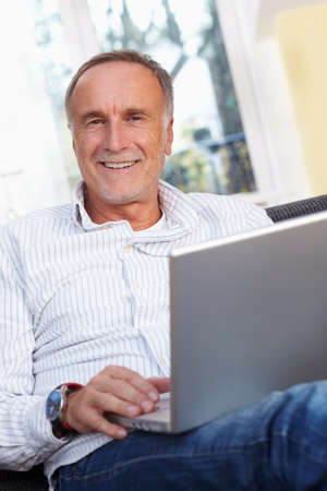 old people: Senior man with laptop at home