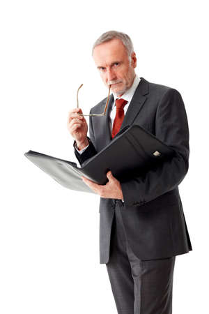 sternly: Strictly mature business man with folder Stock Photo
