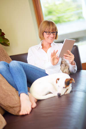 40s: 40s woman with tablet and dog at home