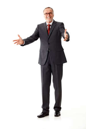 businessman standing: Mature Business man say welcome