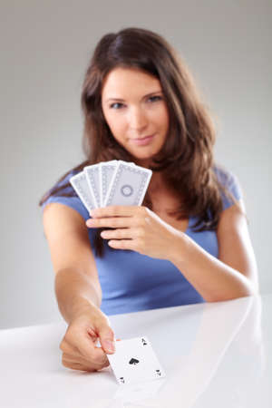 spades: Woman with playing cards, focus on ace of spades, isolated Stock Photo