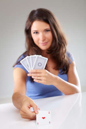 ace of hearts: Woman with playing cards, focus on ace of hearts, isolated