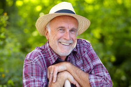 Happy senior gardener with straw hat Archivio Fotografico