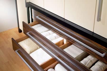 Wardrobe with open drawers Standard-Bild