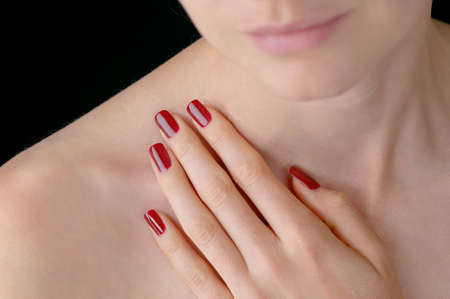feminine beauty: Young beauty with polished artificial red finger nails