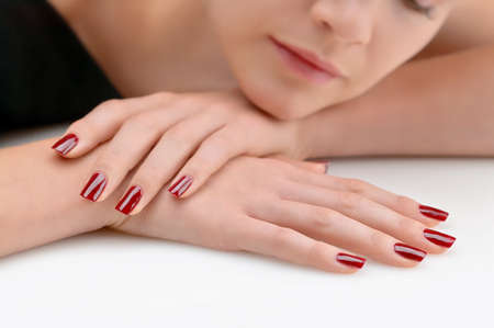 woman in spa: Young beauty with red painted nails, very relaxed Stock Photo
