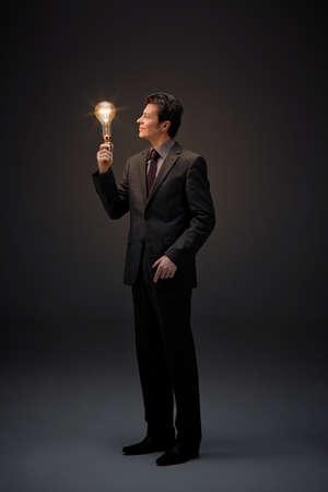enlightment: Illumination of middle aged business man Stock Photo