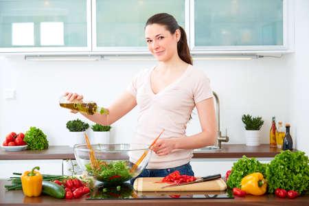 prepare: Young woman prepare salad with oil