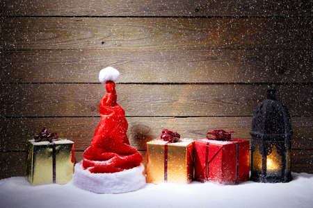 snowfall: Christmas decoration with snowfall and wooden background Stock Photo