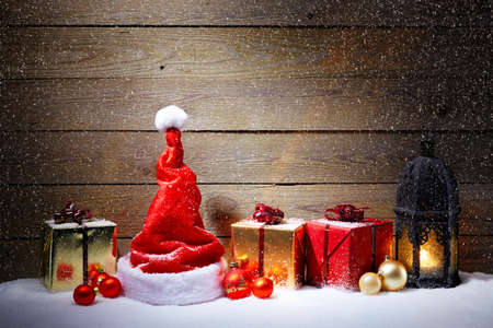 snowfalls: Christmas decoration with snowfall and wooden background Stock Photo