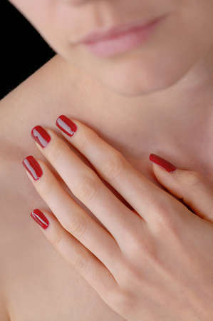 finger nails: Young beauty with red lacquered artificial finger nails