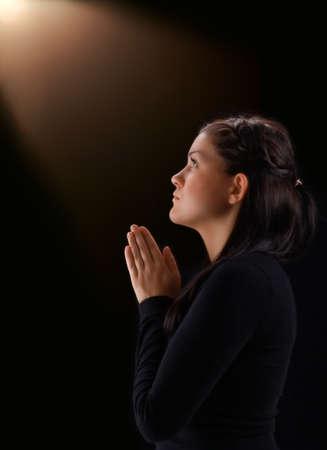 Young woman praying to God