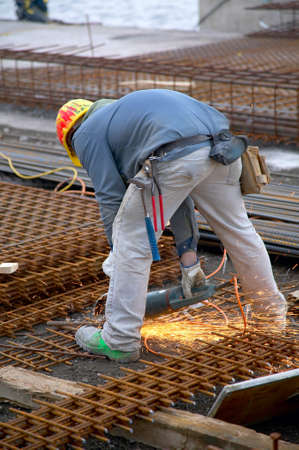 Worker with cutting wheel while cutting
