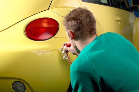 Professional repair of paint damage Stockfoto