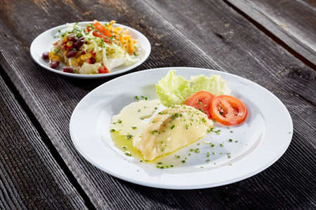 Carinthian pasta on a plate on rustic wooden board