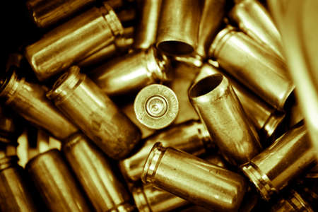 casings: Composition from a several shell casings symbolizing army reserve  Conception on a theme war   Stock Photo