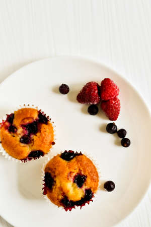 Homemade cupcakes with berries  photo