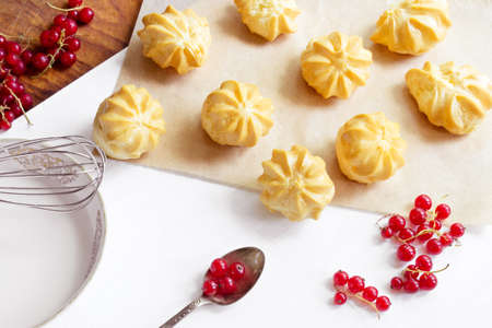 filled: Cream puffs filled sweet custard with redcurrants Stock Photo