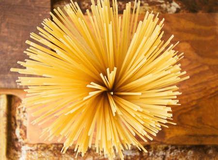 İtalyan mutfağı: Ingredients for Italian cuisine: raw spaghetti on a wooden background Stok Fotoğraf