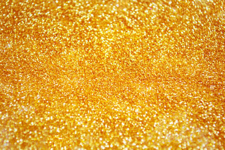 Gold dust texture with glitter. Magical background Stock Photo