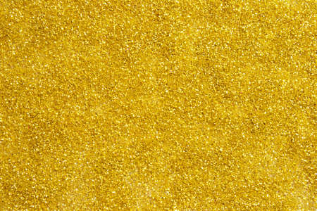 Gold dust texture with glitter. Wonderful holiday background Фото со стока