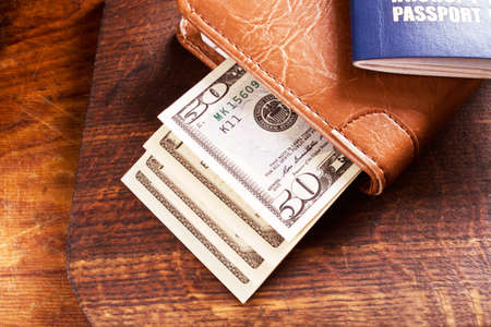international money: Travelling concept with money and international passport Stock Photo