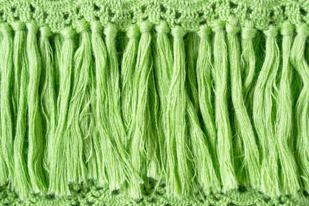 Fancy knitted green fringe for background