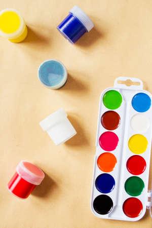 gouache: Watercolor paint palette and gouache tube on canvas