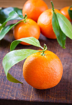 clementine: Clementine oranges on a wooden background Stock Photo