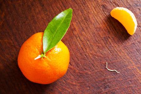 mandarin orange: Fresh mandarin orange on a wooden background