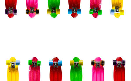 vibrant background: Colored background for a text with many vibrant plastic fish skateboards Stock Photo