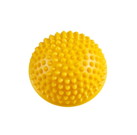 stress relief: Yellow massage hemisphere for stress relief and rehabilitation isolated on a white background