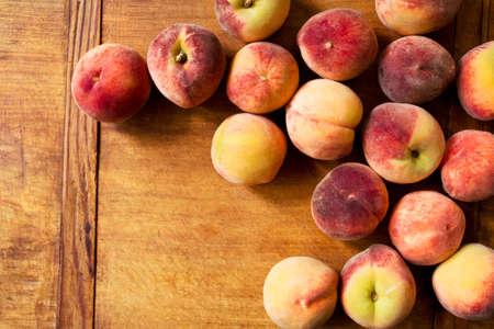 velvety: Fresh peaches on a wooden table