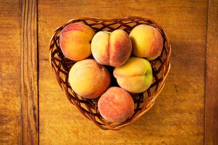 velvety: Fresh peaches in a basket