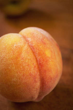velvety: Fresh sweet peach on a wooden table, close-up, selective focus Stock Photo