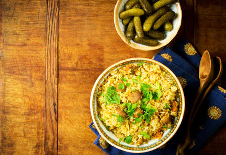 uzbek: Traditional pilaf with meat, carrot and spices