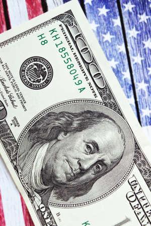 Hundred dollars on United states flag background, vertical image