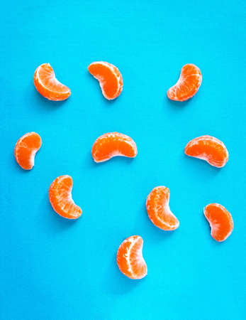 Colorful background with lots of vibrant tangerine slices