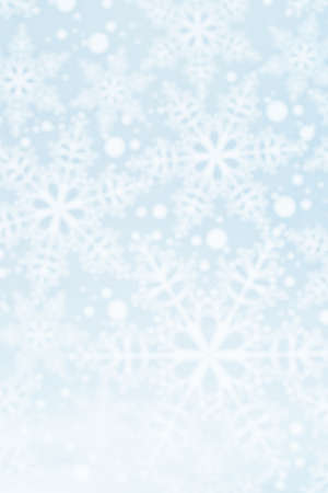 Light defocused winter background with blue snowflakes, vertical image Фото со стока