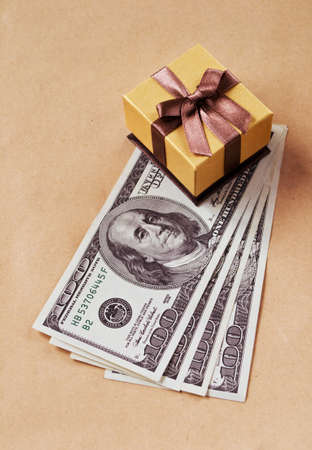 Four hundred dollars and golden gift box Фото со стока