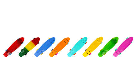 Collection of colorful skateboards isolated on white background with copy space, horizontal image