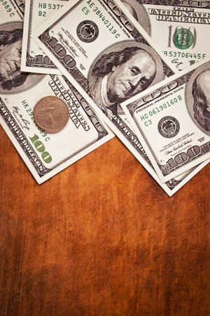 Four hundred US dollars on wooden background with copy space, vertical image