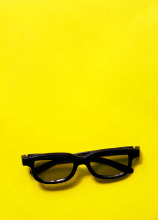 Yellow background with 3d glasses