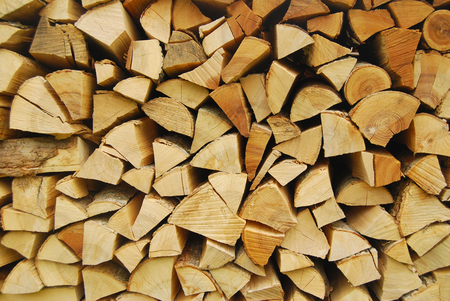 Firewood stacked for winter - firewood background