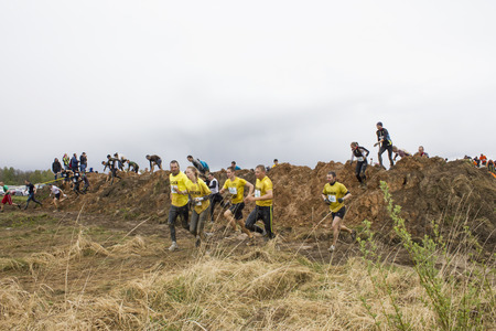 Cinevilla, Latvia - May 4th, 2014: Participants of the strong race 2014. The only extreme mass endurance race in the Baltic States, in which everyone can learn to overcome himself and try his strength and physical fitness by surmounting a dozen of obstacl
