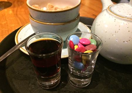 Shot of drinks served with candy