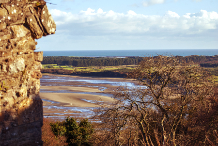 A scenic view from Dundrum Castle ruins. Situated above the town of Dundrum, County Down in Northern Ireland. Imagens